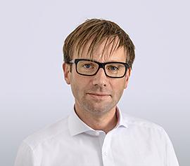 Dr. Christian Schrader